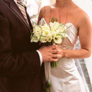 white mini calla lilies poppy pods bridal bouquet