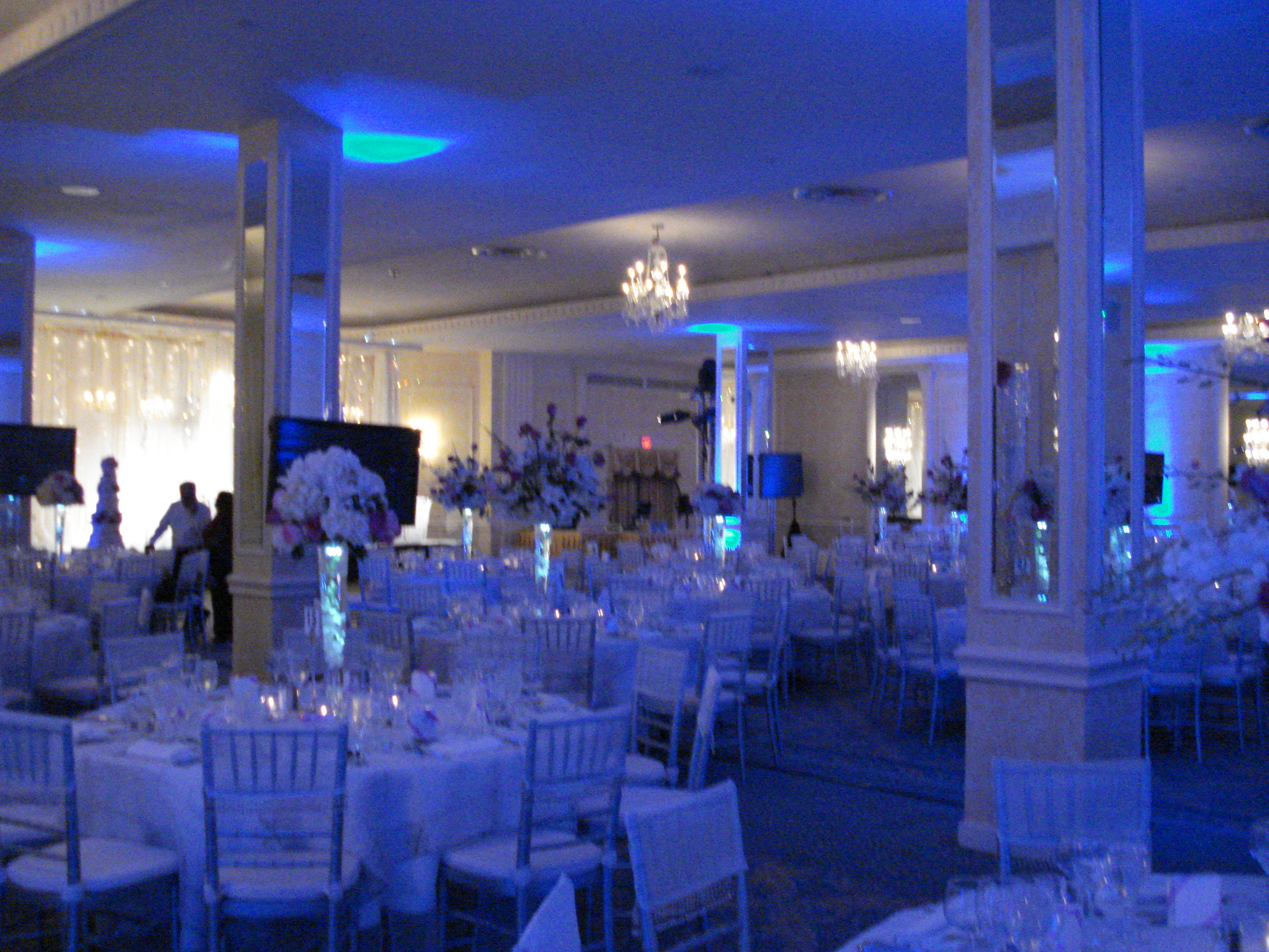 The Blue Room Bathed Ropriately In Lighting Provided Plasma Screens Around So That All Could See Toasts