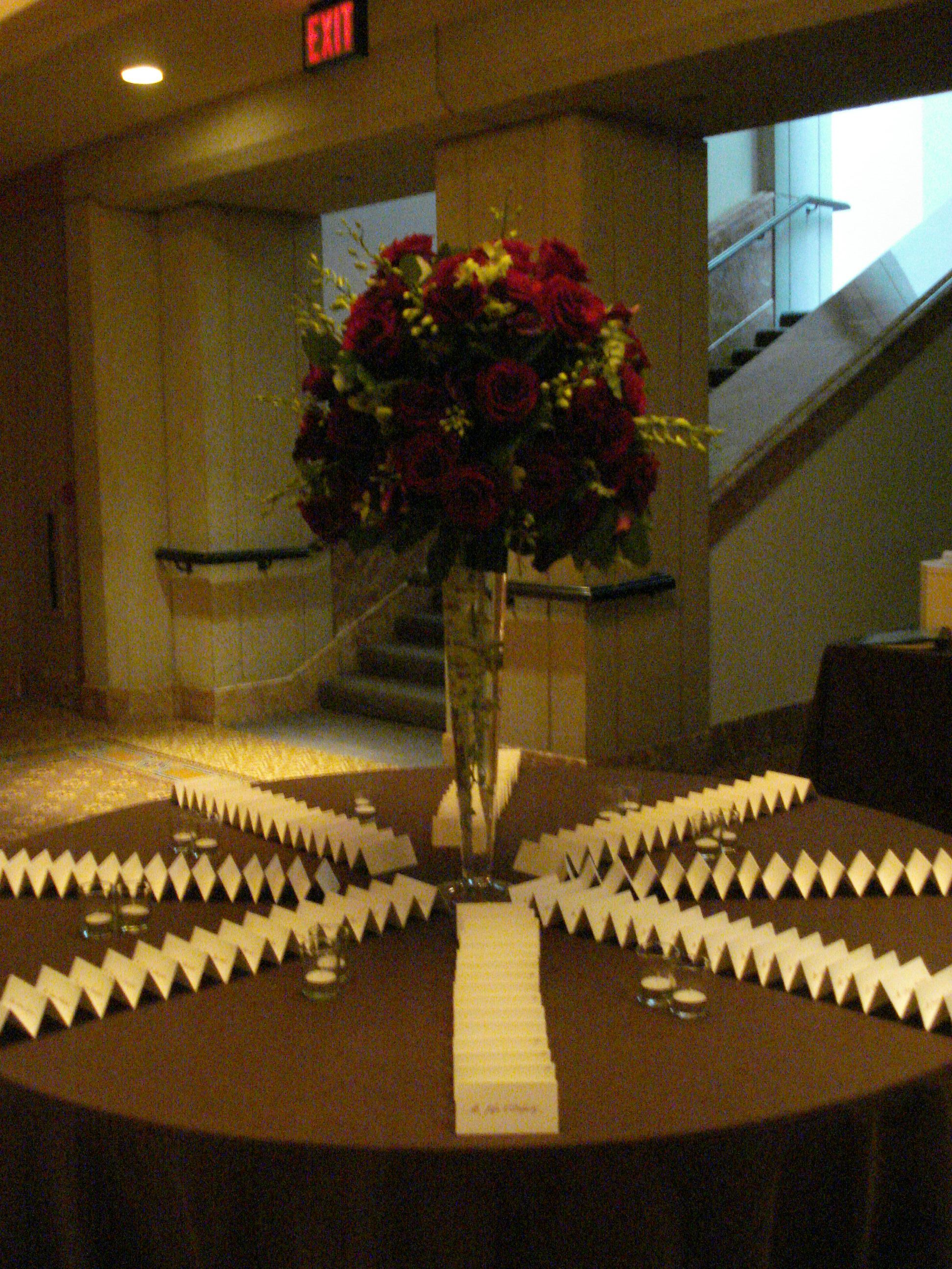 Escort card table at the Park Hyatt Hotel with floral arrangement by Philippa Tarrant