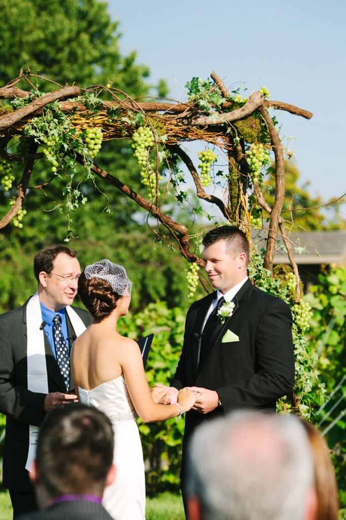 grapevine arch wedding ceremony winery
