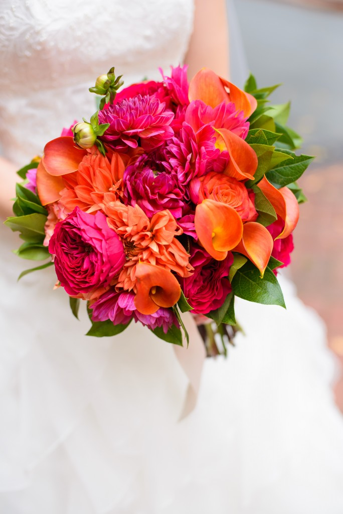 orange pink bridal bouquet growing wild floral design