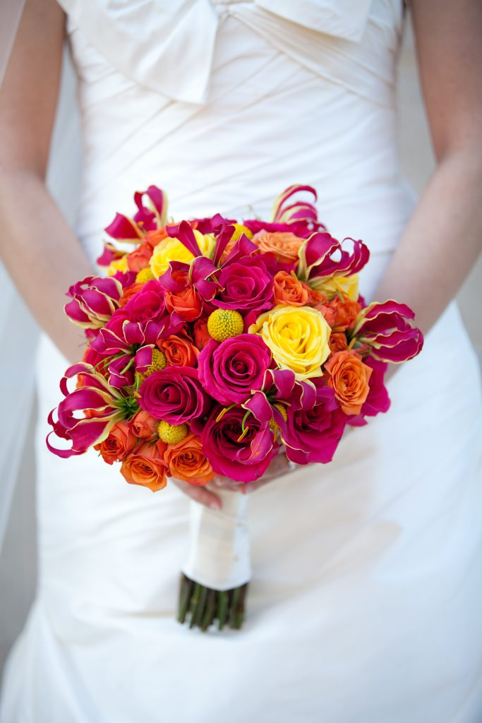 Tierra-Floral-Design-boquet-Gloriosa-orchids-hot-pink-roses-yellow-roses-billy-balls-orange-spray-roses