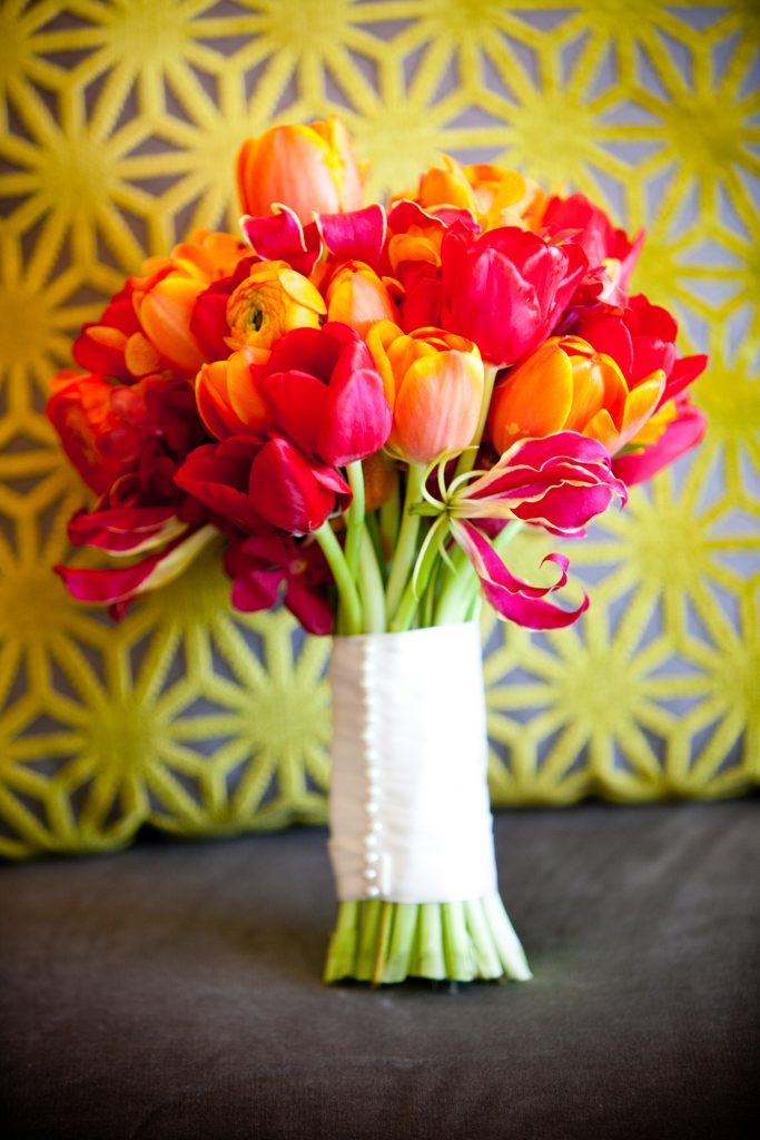Yellow-Door-Floral-Design-bouquet-red-orange-hardy-Van-Dyke-tulips-mokara-orchids-range-ranunculus-variegated-gloriosa-lilies