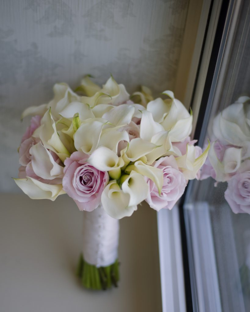 white-mini-calla-lilies-pink-roses-bridal-bouquet-Petals-Edge