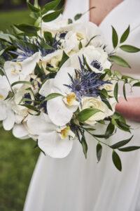 bridal-bouquet-white-cymbidium-orchids-anemones-thistle-greenery