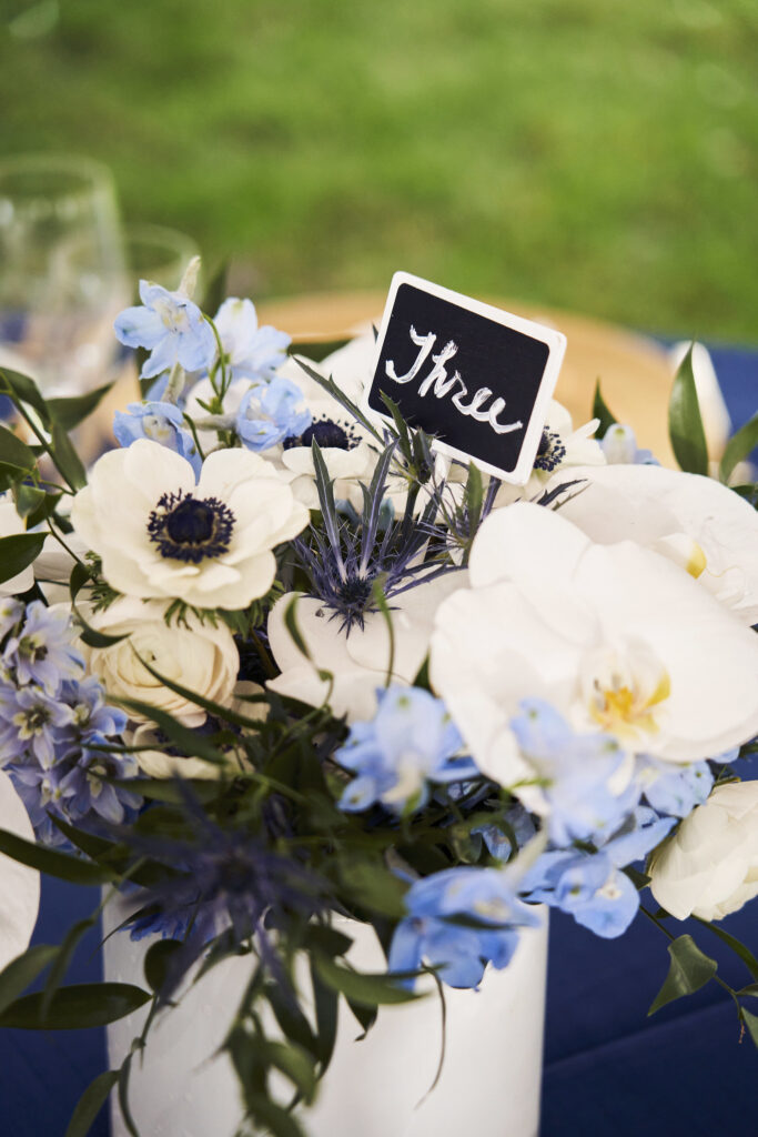 low-floral-centerpiece-orchids-anemones-thistle-delphinium-blue-white