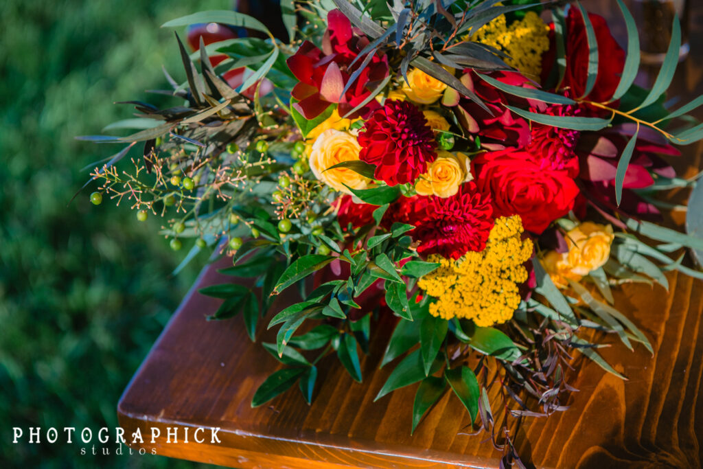 bridal-bouquet-loose-red-yellow-roses-dahlia-yarrow-texture